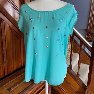 Turquoise blouse with decorative silver caps